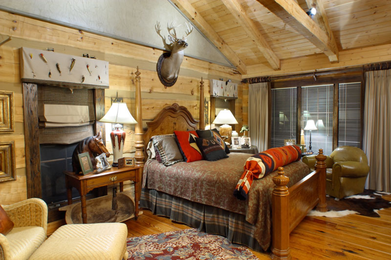 guest bedroom 1 has a fishing hunting theme the gable end uses a
